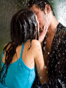 Young couple hugging under a rain